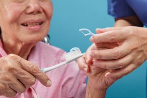 Senior Brushing Teeth